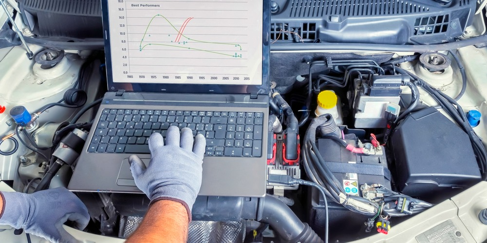 automotive diagnostics mechanic performing troubleshooting tests